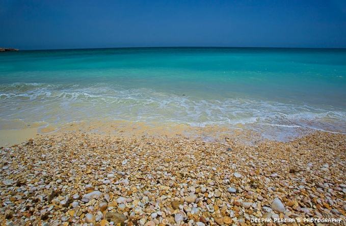 Pebble beach, Oman