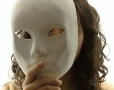 vintage-girl-silhouette-mask-mystery-cu-cc-the-silhouette-of-a-mysterious-young-woman-hides-her-face-behind-a-plain-white-mask-close-up-shot_71yxqb0w__S0000.jpg